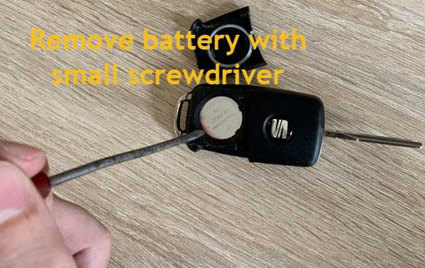 Photo how to remove the battery with a little screwdriver